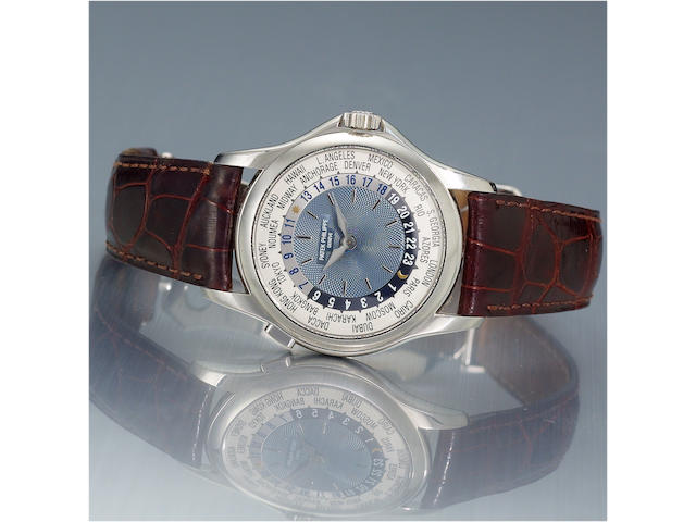 Patek Philippe. A very fine automatic  platinum World Time wristwatch with a platinum Patek Philippe deployant clasp together with  fitted box and a certificate of origin  Ref 5110P, 3212492, Case No 4236474, Ref. 5110P. Sold November 2004.
