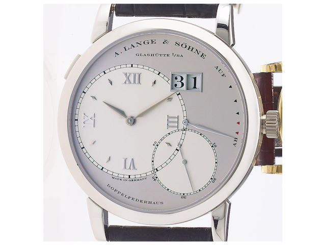 A. Lange & Söhne. A fine and rare platinum wristwatch with oversized date and power-reserve with fitted factory box and papers Lange 1, Ref:115.025. Movement No.38765 Sold November 2004