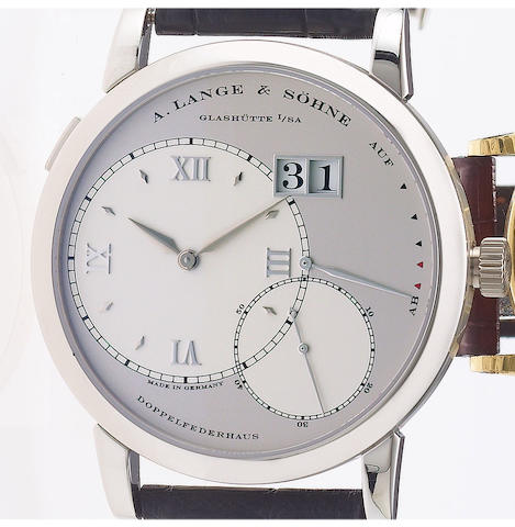 A. Lange & Söhne. A fine and rare platinum wristwatch with oversized date and power-reserve with fitted factory box and papersLange 1, Ref:115.025. Movement No.38765 Sold November 2004