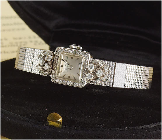 Patek Philippe. A fine platinum and white gold diamond set bracelet watch with original Certificate, bill of sale and Patek Philippe fitted boxRef:3146/20, Case No.2602414, Movement No.949163, Sold 5th May 1958