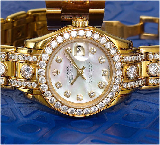 Rolex. A fine and rare lady's 18ct gold diamond set calendar bracelet watchPearlmaster, Datejust, Sold in April 1998