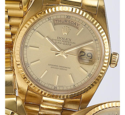 Rolex. An 18ct gold centre seconds calendar bracelet watchDay-Date, 1981