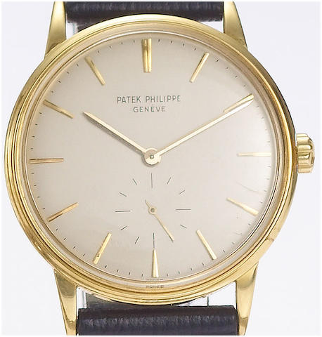 Patek Philippe. A fine 18ct gold automatic wristwatch with Certificate of Origin