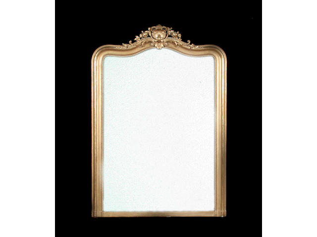 A 19th century French giltwood and composition overmantel mirror