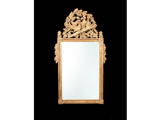 A Louis XVI style giltwood and composition mirror