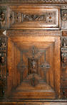 A late 19th century Flemish carved oak press cupboard