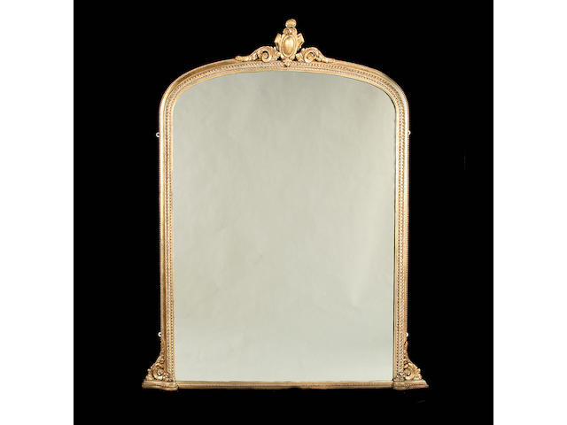 A 19th century gilt carved and composition overmantle mirror