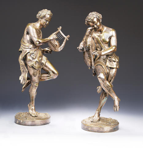 An early 20th century pair of plated on brass figures