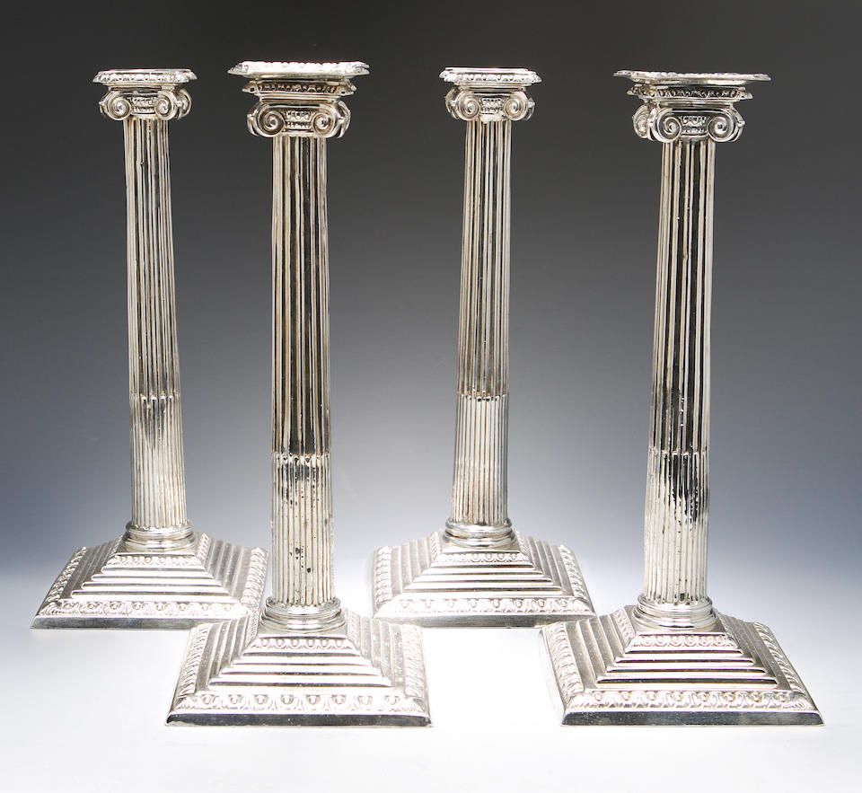 A set of four George III candlesticks Possibly by Edward Aldridge and John Vere, London 1763,  (lacking two sconces)