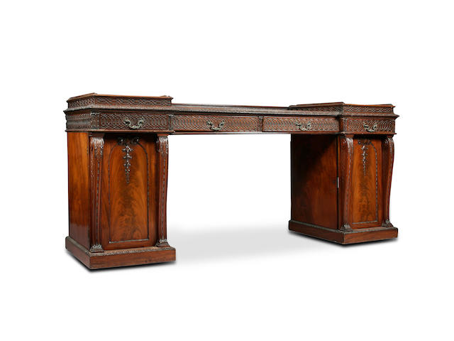 A large William IV and later mahogany pedestal sideboard
