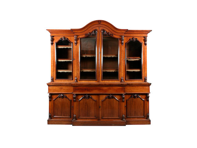 A Victorian figured mahogany breakfront secretaire bookcase