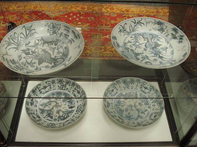 Four blue and white Ming style chargers