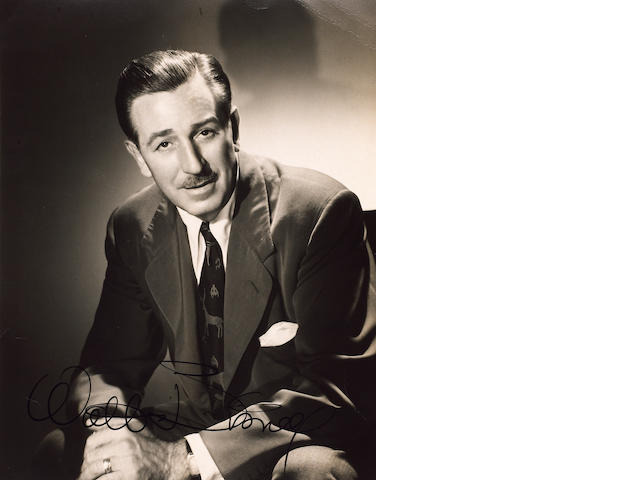 A signed photograph of Walt Disney,