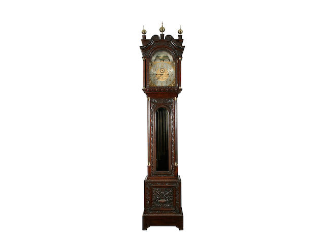 A good early 20th century carved oak-cased three-train chiming longcase clock sold with three brass weights, pendulum, nine tubular gongs, key and winder