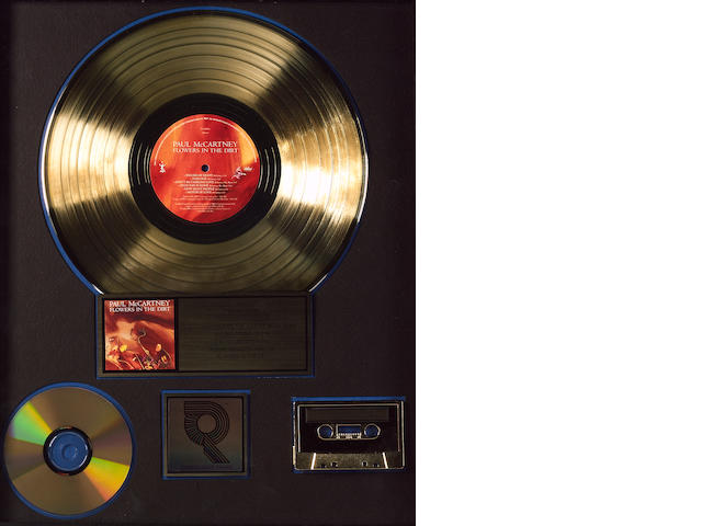 A 'gold' award for the album, CD and cassette, 'Flowers In The Dirt' by Paul McCartney,