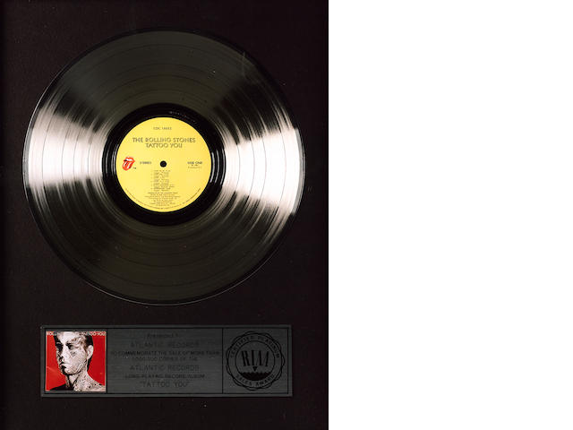 A 'platinum' award for the album 'Tattoo You' by the Rolling Stones, US,