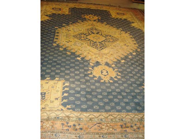 A large Ushak type carpet 490cm x 379cm