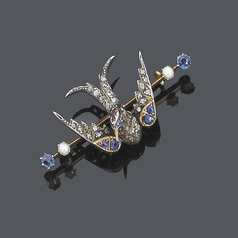 A sapphire, ruby, diamond and half-pearl bird brooch, circa 1900