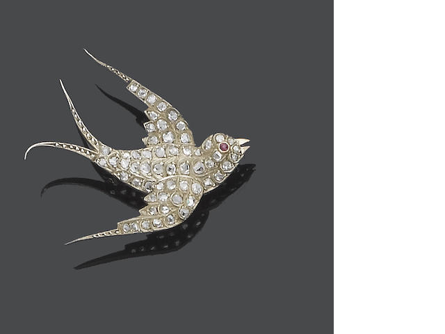 A diamond and ruby bird brooch,