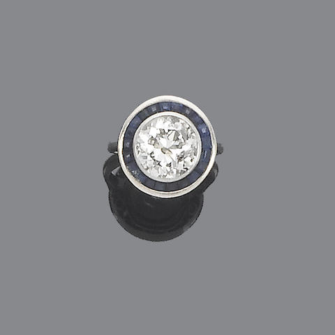 A sapphire and diamond target cluster ring,
