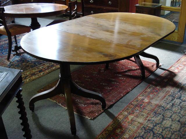 A 19th century mahogany oval dining table