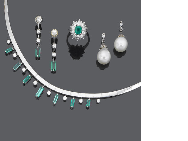 An emerald and diamond necklace, pair of earrings, a ring and a pair of cultured pearl and diamond pendent earrings