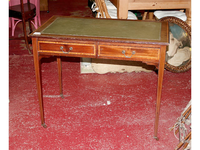 An Edwardian mahogany writing table