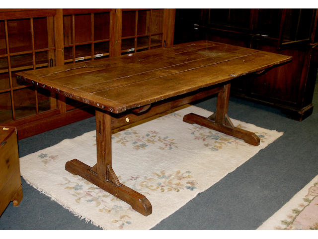 A 17th century style oak trestle dining table