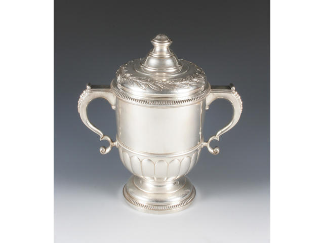 A twin handled trophy cup and cover By Mappin and Webb, Sheffield, 1962,