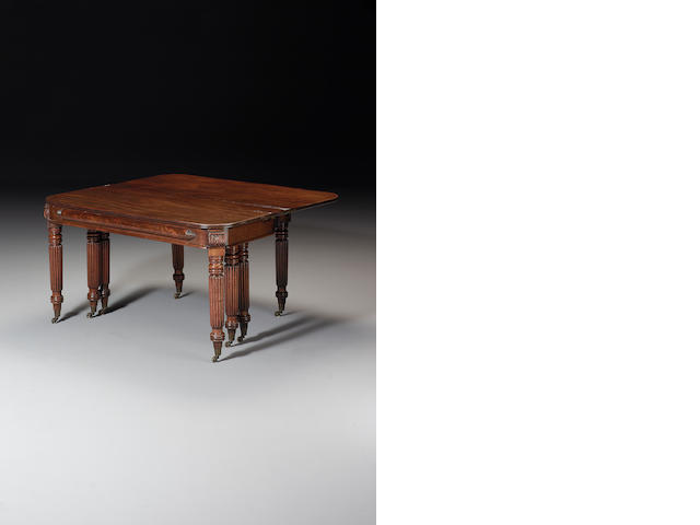 A George IV mahogany concertina-action Dining Table