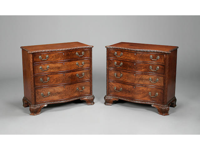 A pair of mahogany serpentine chests