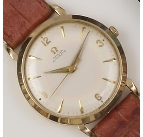 Omega: A 9ct gold gentleman's automatic wristwatch,