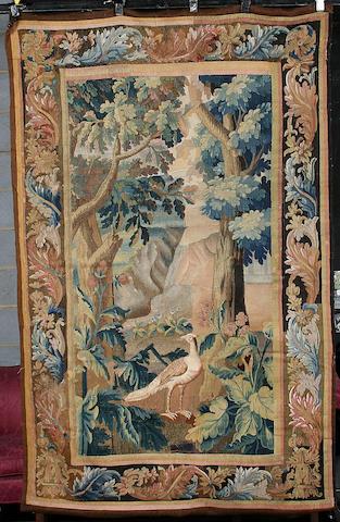 A 17th century Flemish Verdure tapestry Belgium, 239cm high, 181cm wide.