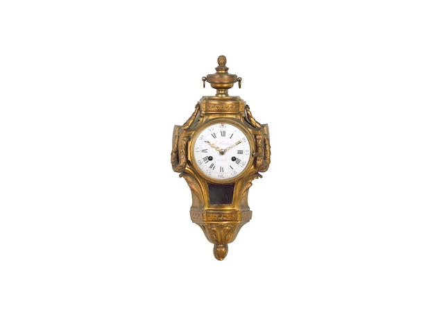 A mid to late 19th Century French bronze cartel clock, Le Faucheur a Paris,