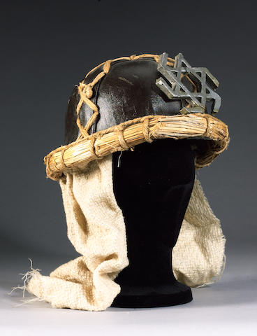 A suicide squad helmet from 'Monty Python's Life Of Brian', 1979,