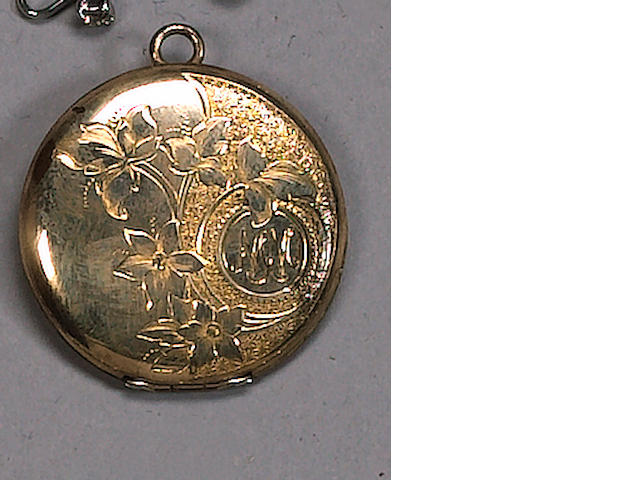 A gold effect locket, reported to be the former property of Marilyn Monroe,
