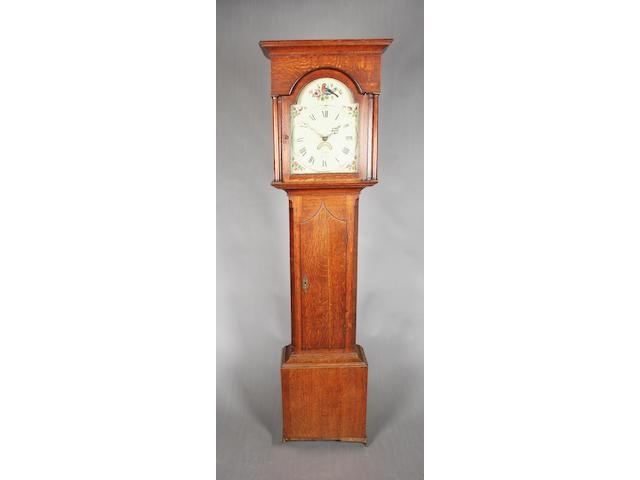 An early 19th century oak longcase clock
