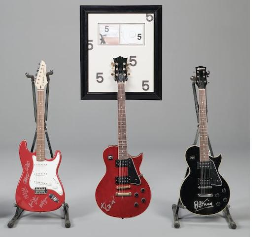 A collection of three autographed guitars, Lenny Kravitz, BB King and AC/DC,3