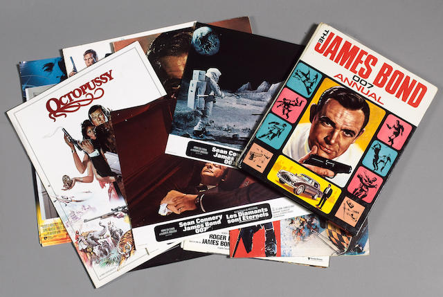 A collection of James Bond film related brochures, stills and lobby cards, including;