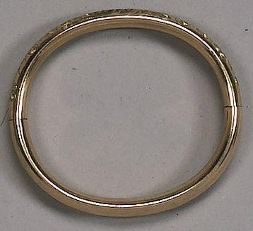 A gold finished bangle, reported to be the former property of and worn by Jean Harlow,