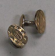 A pair of gold finished cuff links, reported to be the former property of Clark Gable,