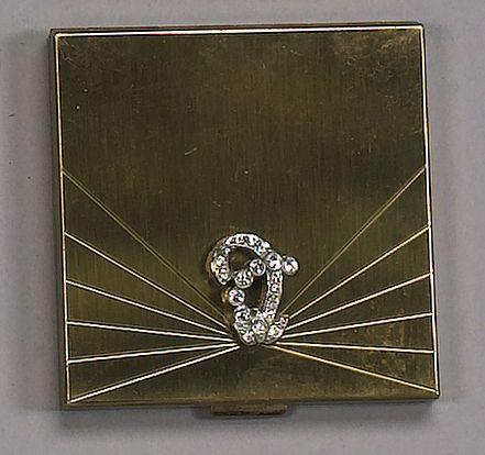A gold finished compact with rhinestone motif, reported to be the former property of Audrey Hepburn,