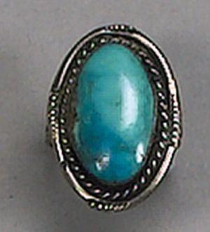 A silvered metal and turquoise ring,  reported to be the former property of Bette Davis,