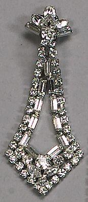 A rhinestone necklace and earring set,  reported to be the former property of Mae West,