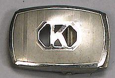 A silver belt buckle, reported to be the former property of Buster Keaton,