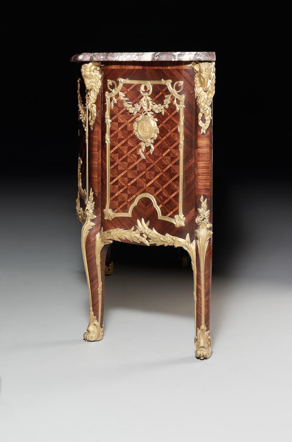 A Louis XV style ormolu-mounted kingwood, tulipwood and parquetry commode médaillierIn the manner of Antoine Gaudreaux, by Henry Nelson, Paris, Third-quarter 19th century