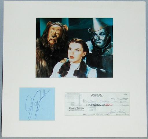 Judy Garland, Jack Haley and Errol Flynn autographs, the Judy Garland and Jack Haley being mounted together with Wizard of Oz still,