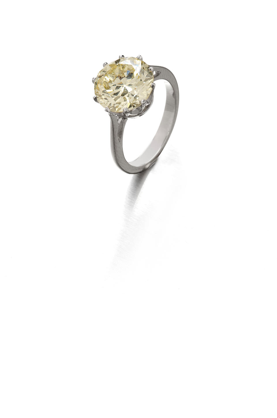 A yellow diamond single-stone ring