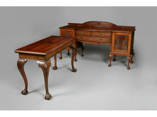A good early 20th century walnut dining suite in the 18th century style
