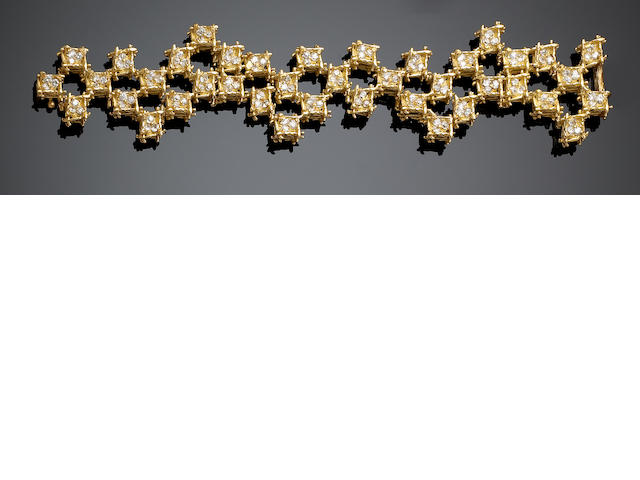 An abstract design 18ct gold and diamond bracelet and earrings